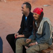 Two local men sitting by the campfire, enjoying an afternoon in Wadi Rum.