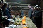 An evening buffet of traditional Bedouin salads, hummus, pita bread, fruit, and barbecue.